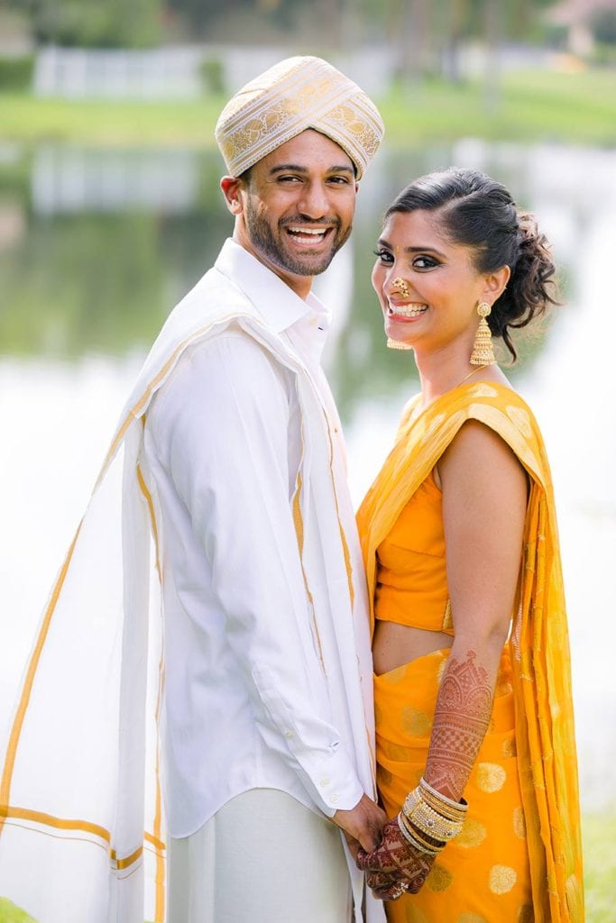 indian bride and groom in gold sari