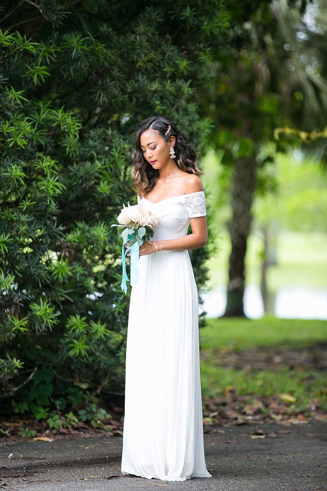 wedding photographer in robbins preserve, davie | bride poses for portrait in robbins park
