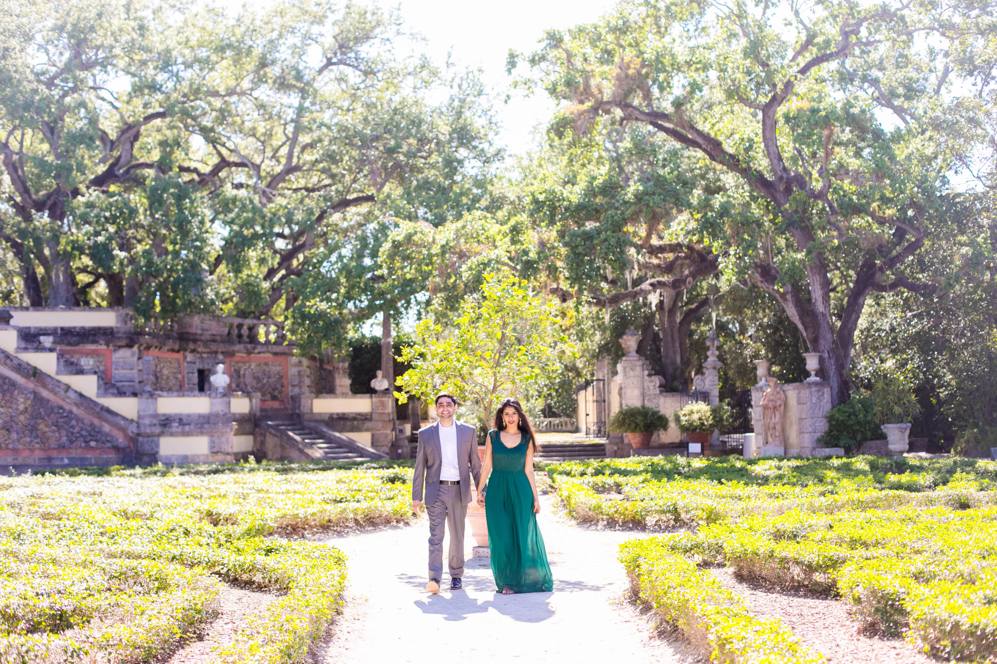 couple walking in vizcaya museum, miami for their modern indian engagement photoshoot