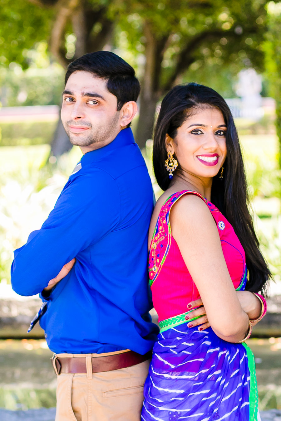 indian engagement photoshoot at vizcaya   couple stand back to back in traditional indian clothing