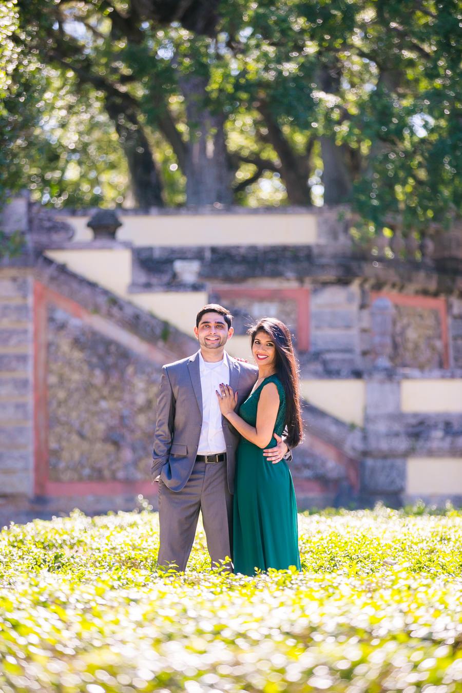 beautiful modern indian engagement photo shoot in vizcaya museum   long green dress