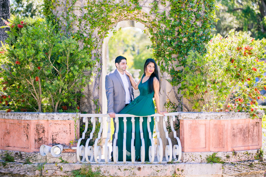modern indian couple pose for engagement photoshoot at vizcaya museum in miami