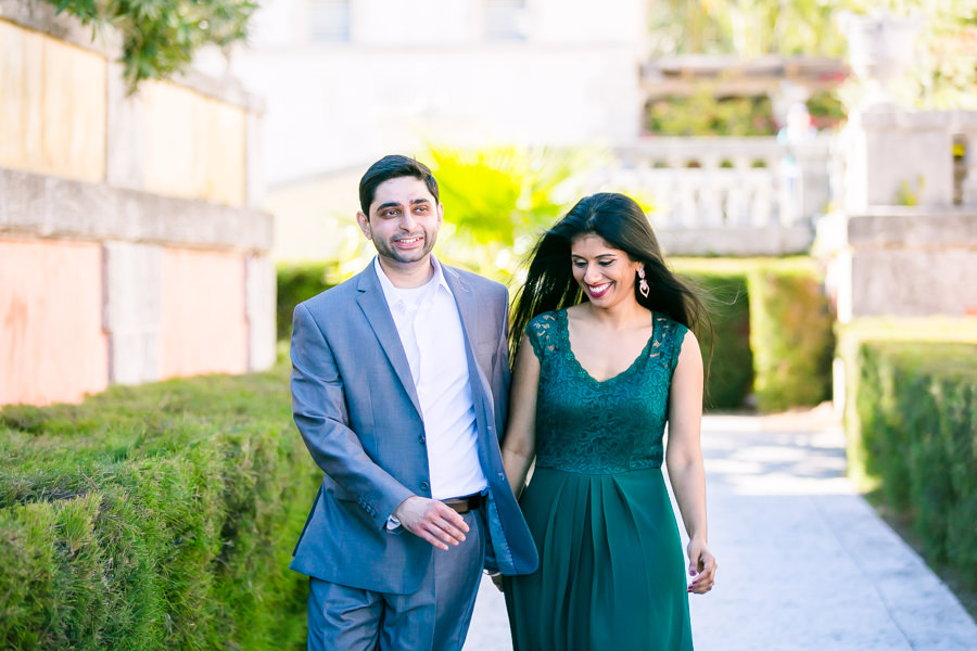 modern indian couple get engaged in vizcaya museum   long green dress