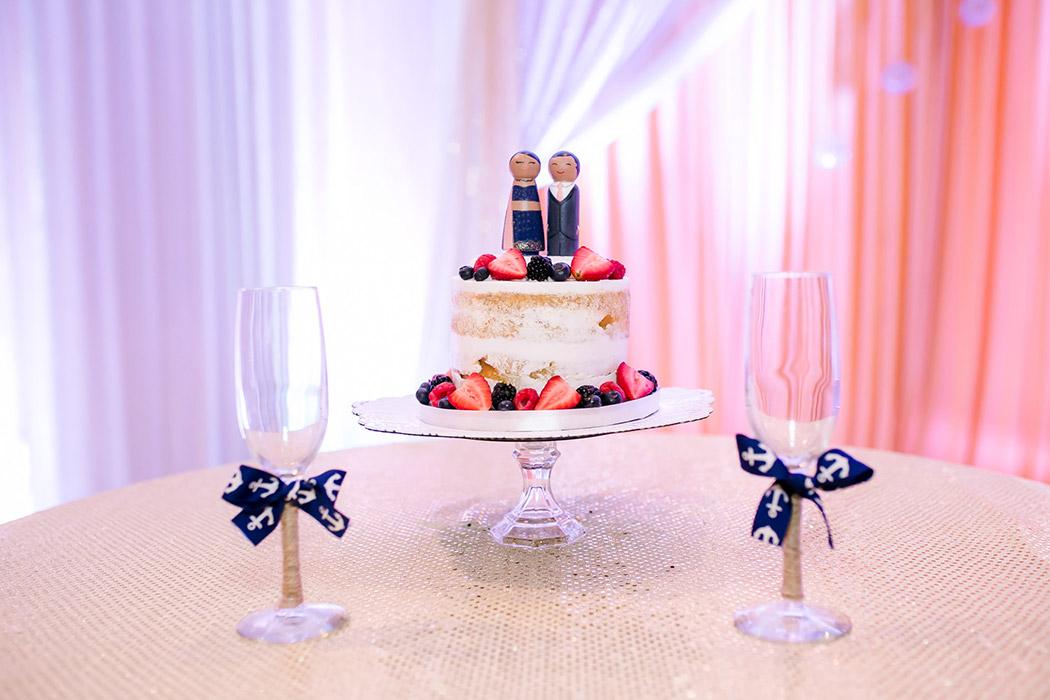 modern and fun indian wedding cake with indian wedding cake topper