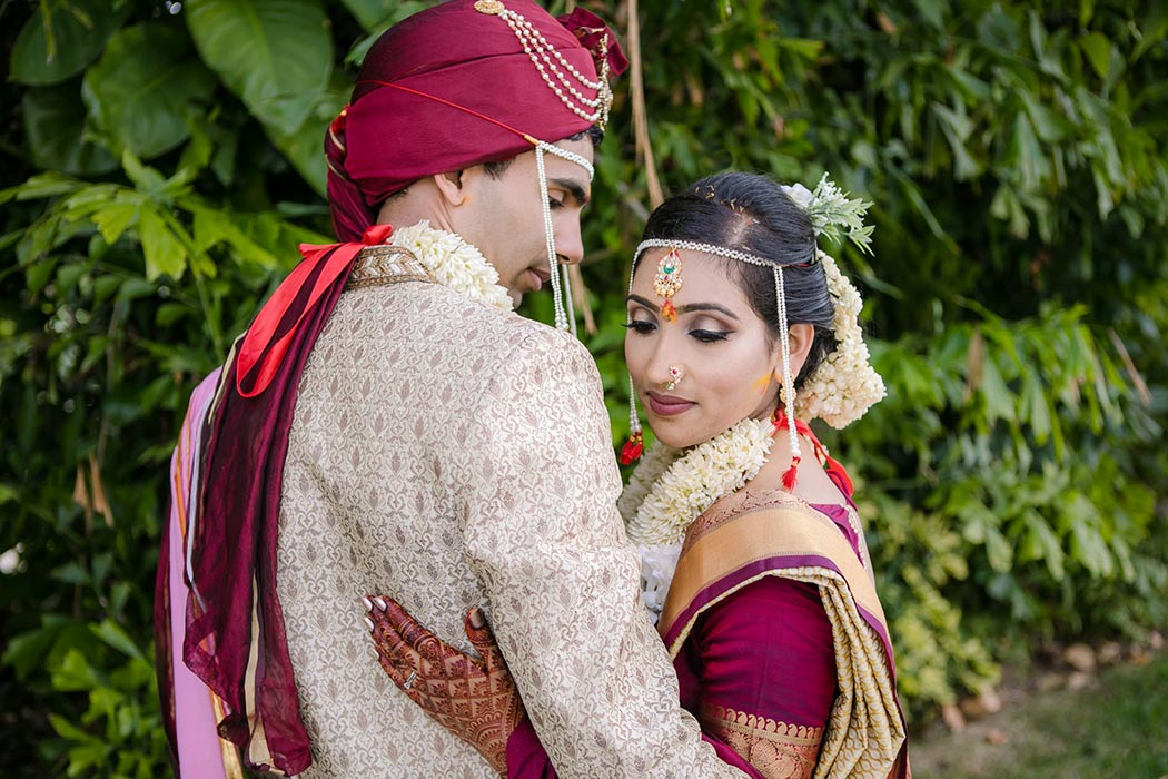 indian bride and groom pose for wedding pictures at bahia mar fort lauderdale