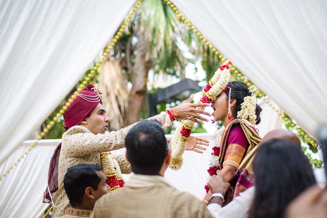 indian bride and groom photographed during the Jaimala ceremony exchange in south florida
