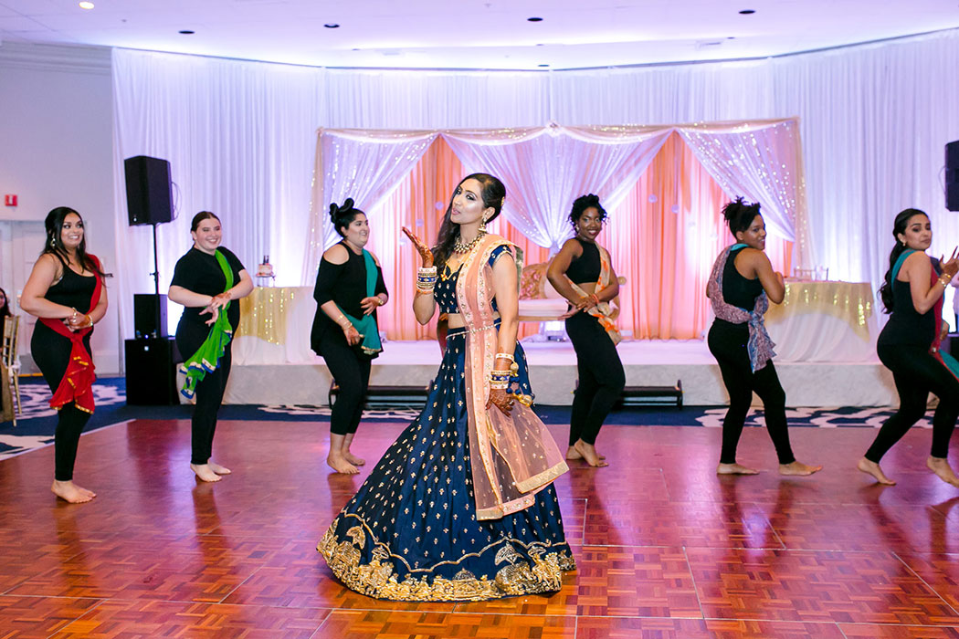 south florida indian wedding photographer | indian wedding reception dance performance at bahia mar fort lauderdale