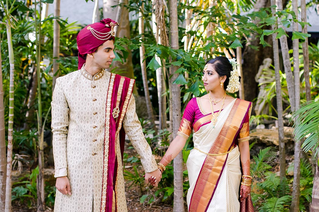indian bride and groom in traditional gold and red wedding outfit at bahia mar fort lauderdale