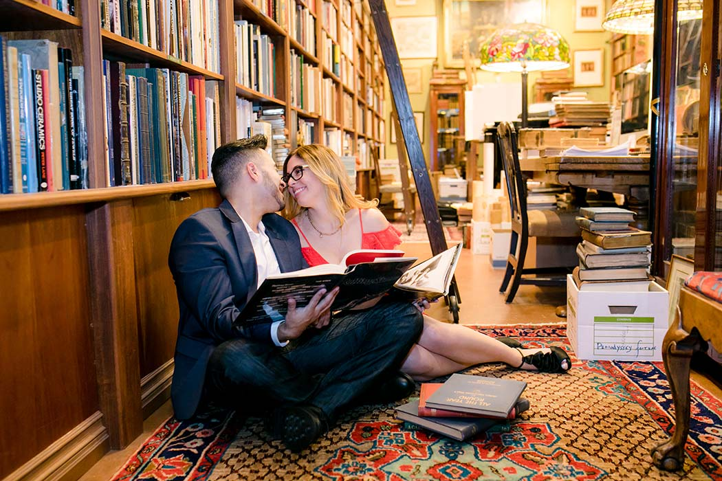 posing idea for book store engagement session in fort lauderdale