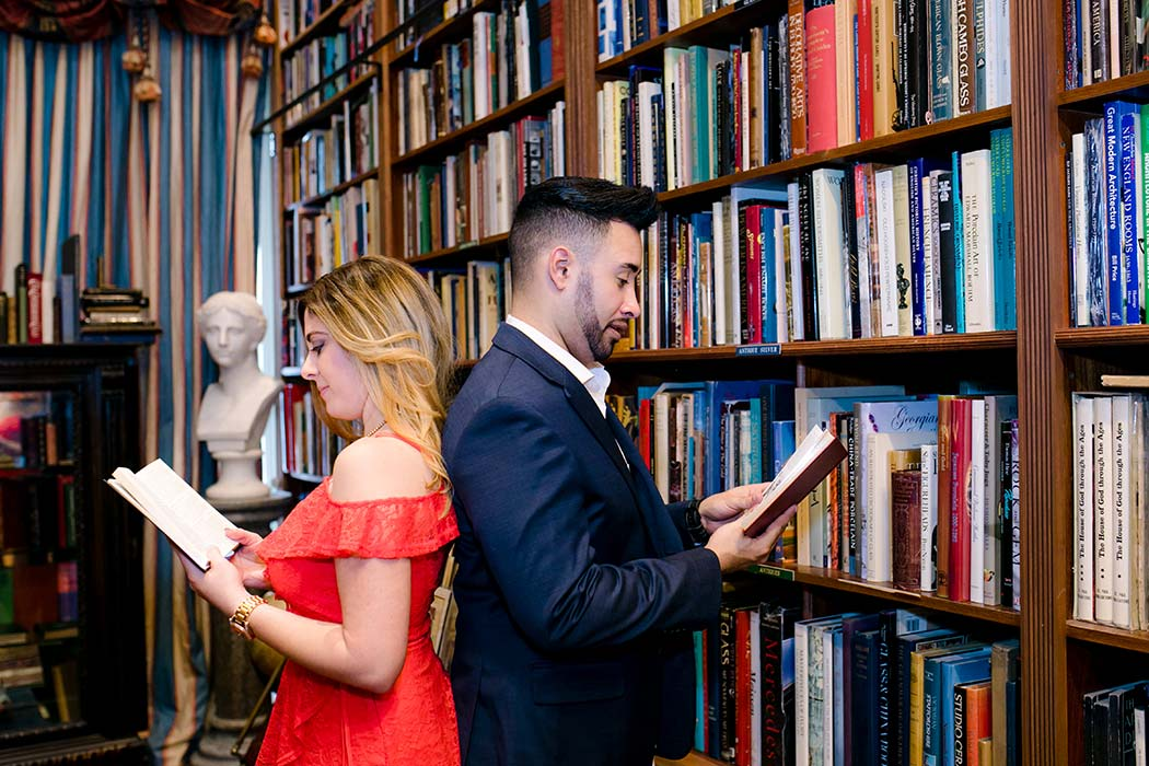 cute posing idea for a couple having their engagement session in a book store | fort lauderdale wedding photographer