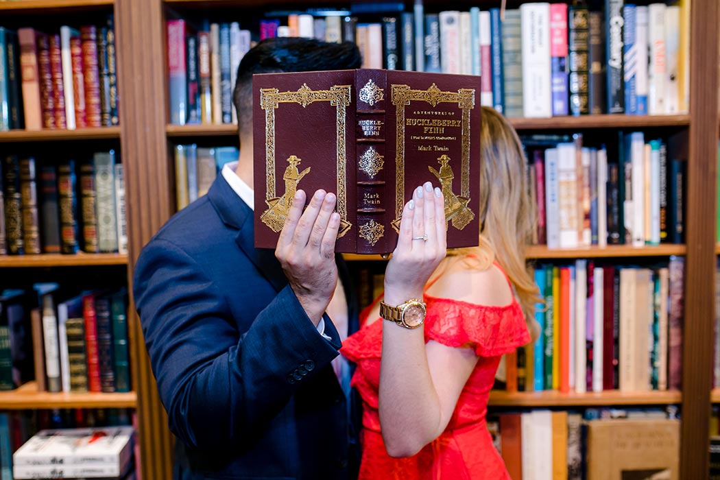 cute posing idea for couples book store engagement session | fort lauderdale wedding photographer