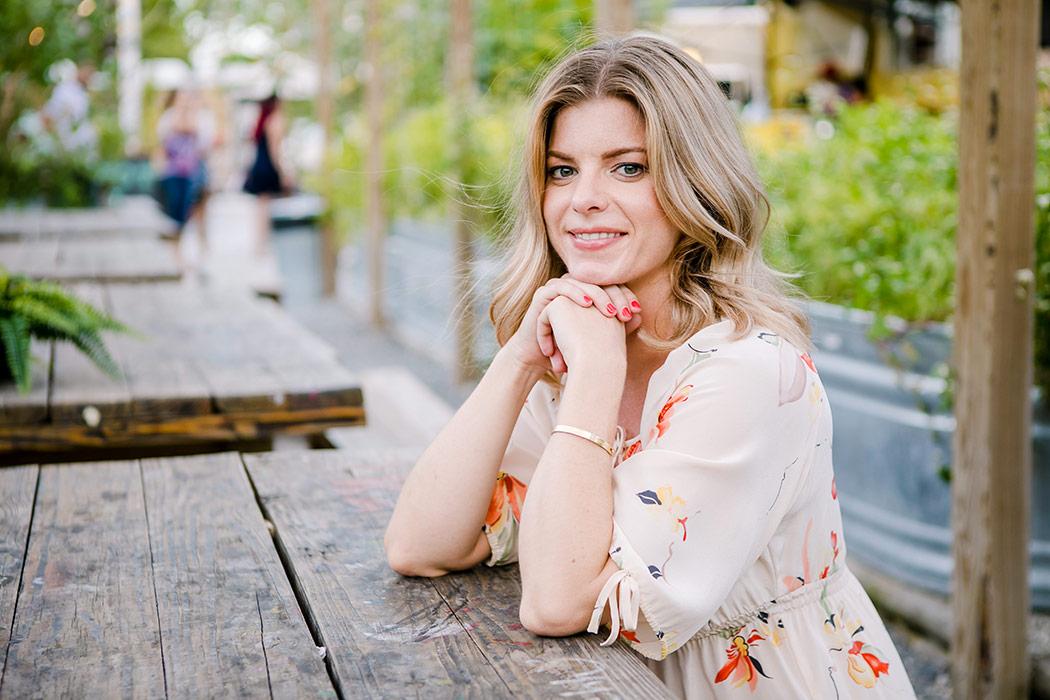 girl poses for lifestyle photoshoot in wynwood yard