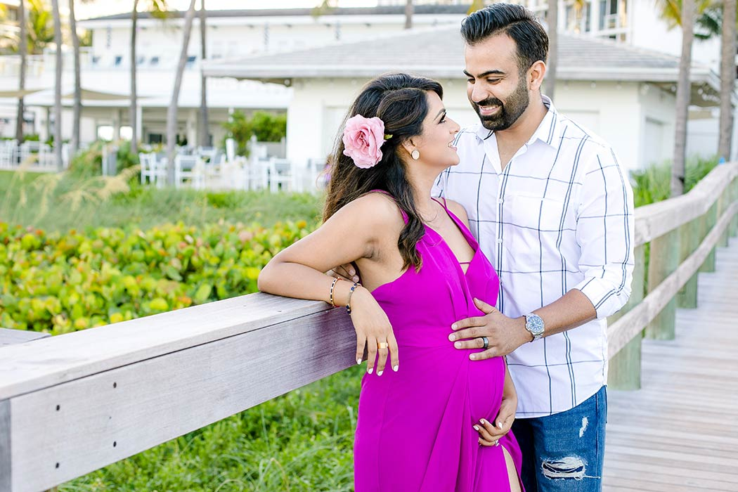 maternity photoshoot with pink maternity dress | beach maternity photographer fort lauderdale south florida