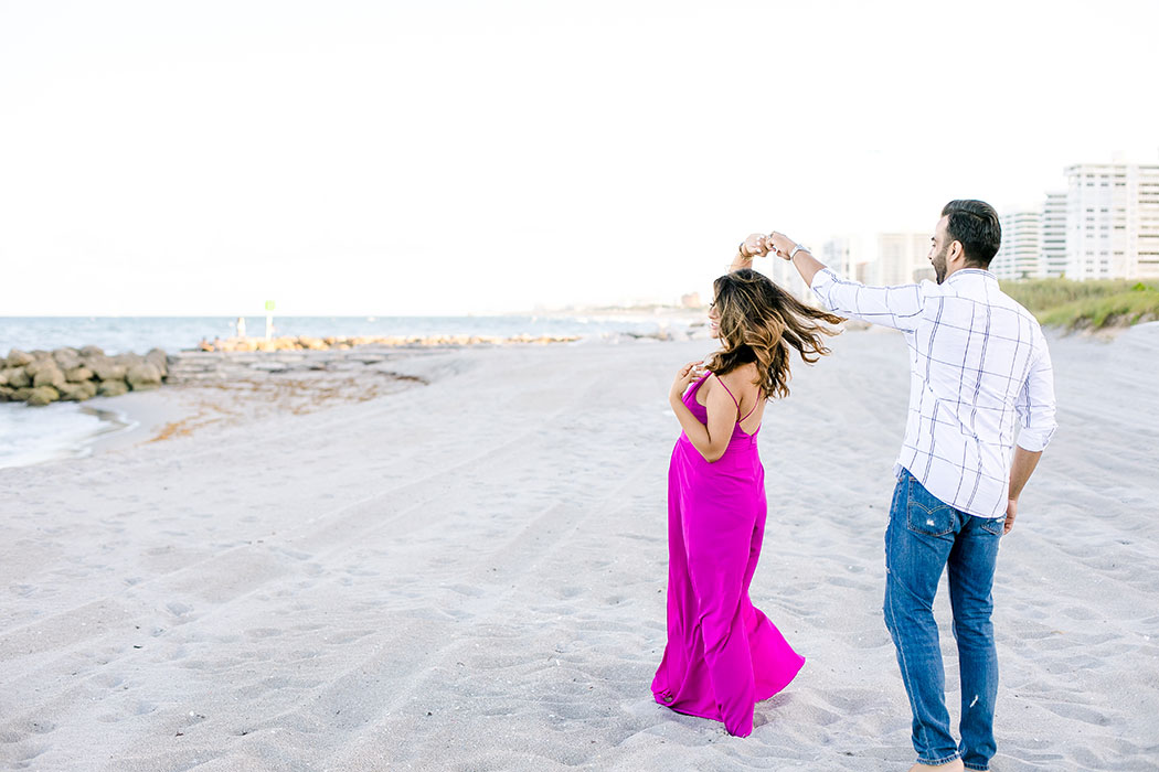 maternity photoshoot in fort lauderdale on beach   dancing couple on beach   pink maternity dress