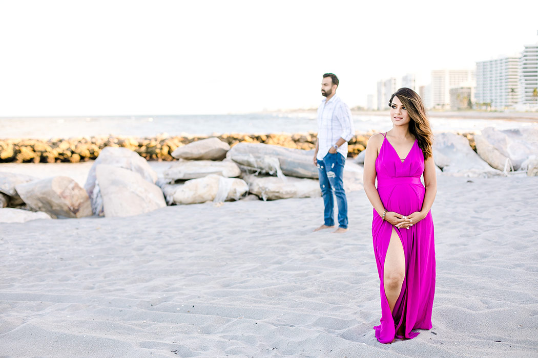unique posing idea for beach maternity session with couple   sunset beach maternity photoshoot