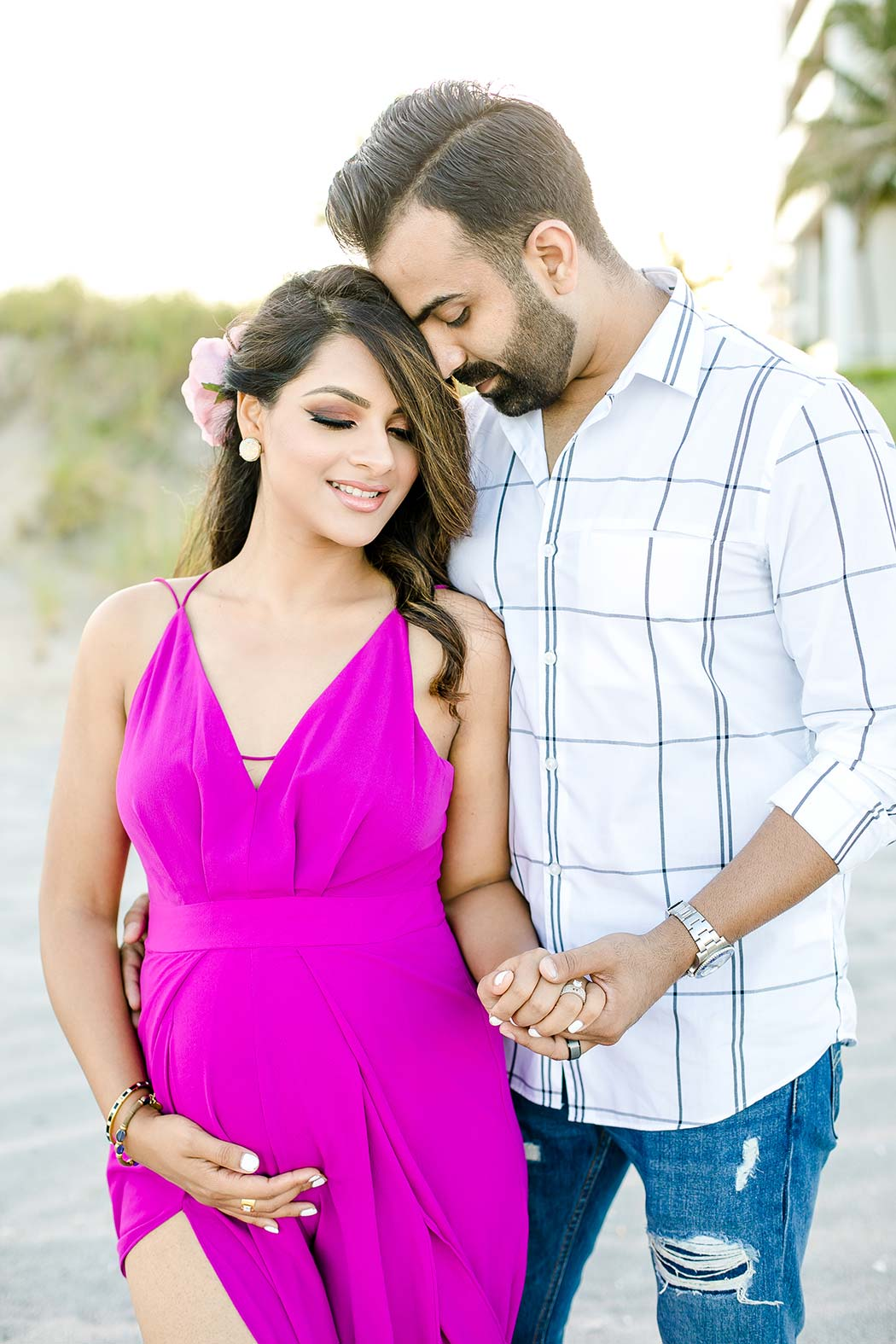 boca raton beach maternity photoshoot with couple   pink maternity dress