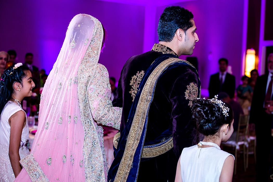 indian bride and groom enter their wedding reception at bonaventure resort and spa