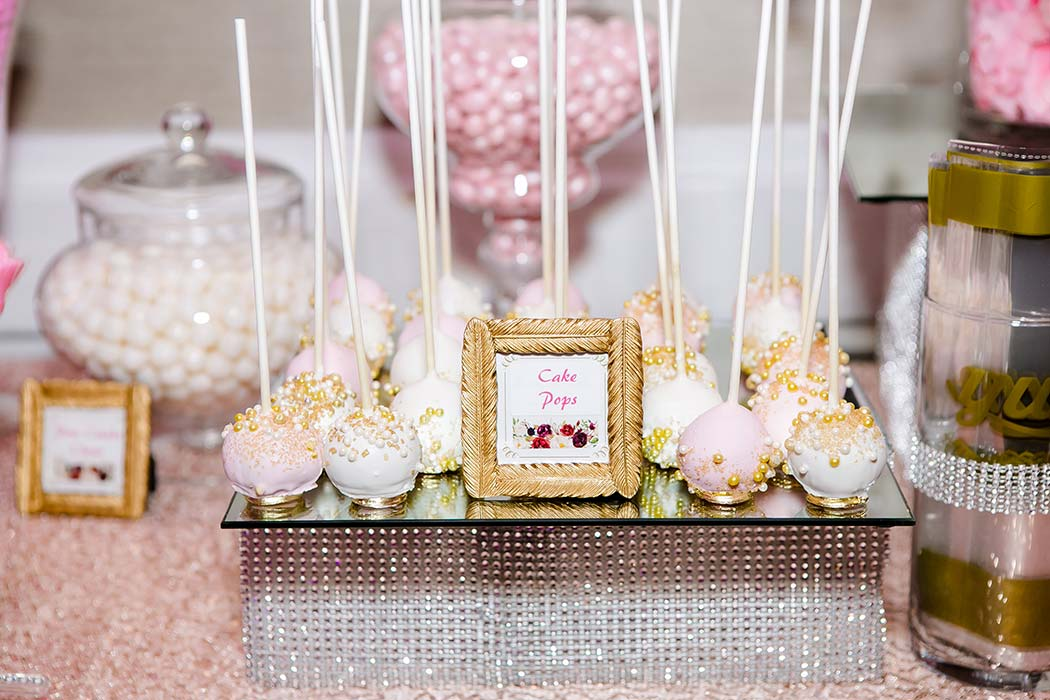 beautiful pink and white wedding candy table
