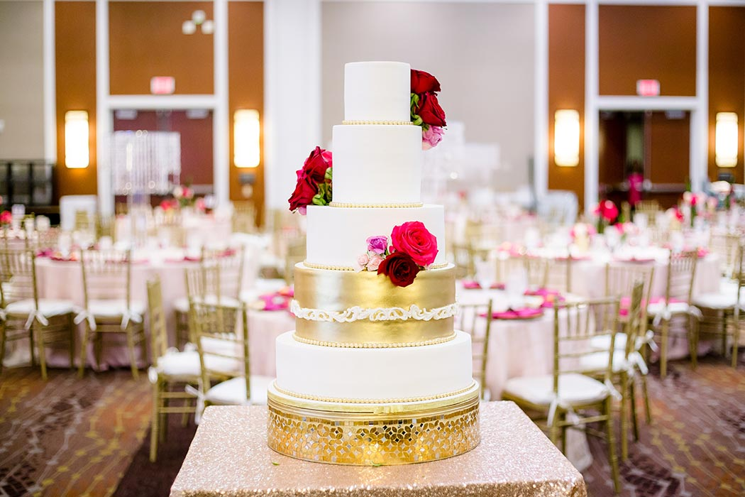 gorgeous modern indian wedding cake with gold and white tiers
