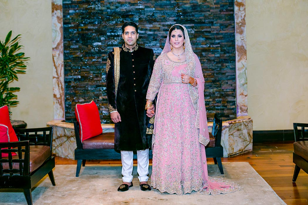 indian bride and groom | bride wearing pink and gold wedding dress | fort lauderdale wedding photographer