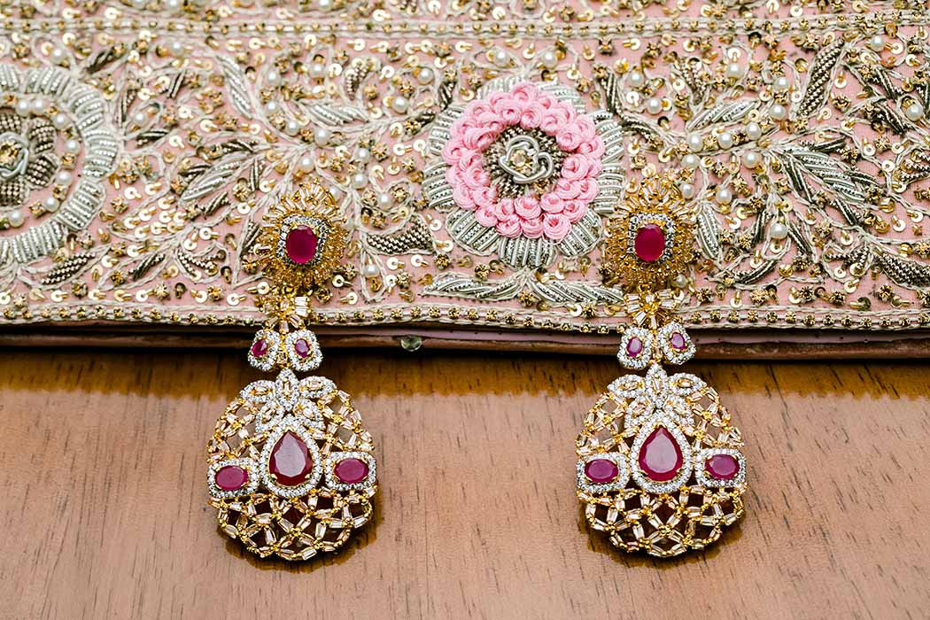beautiful gold and red stone drop earrings and beaded bag for indian wedding | south florida indian wedding photographer