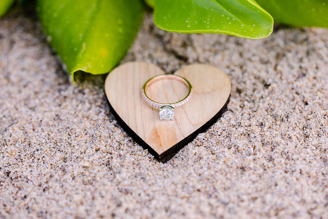rose gold diamond engagement ring on wooden heart | natural beach engagement photography fort lauderdale