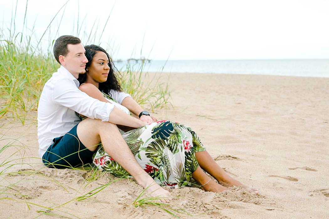 sitting pose on beach during engagement photography session | natural beach engagement photo ideas
