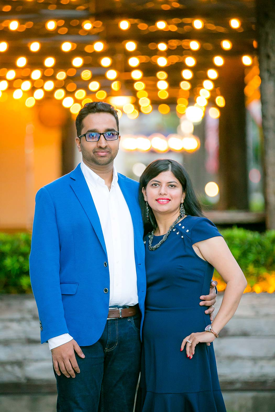 indian couple pose for family photos with lights in background on las olas boulevard | family photographer fort lauderdale