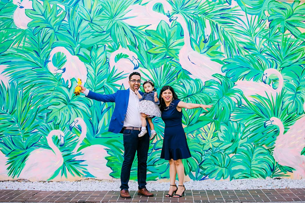 fun family photography session on las olas boulevard with flamingo mural wall | family photographer south florida