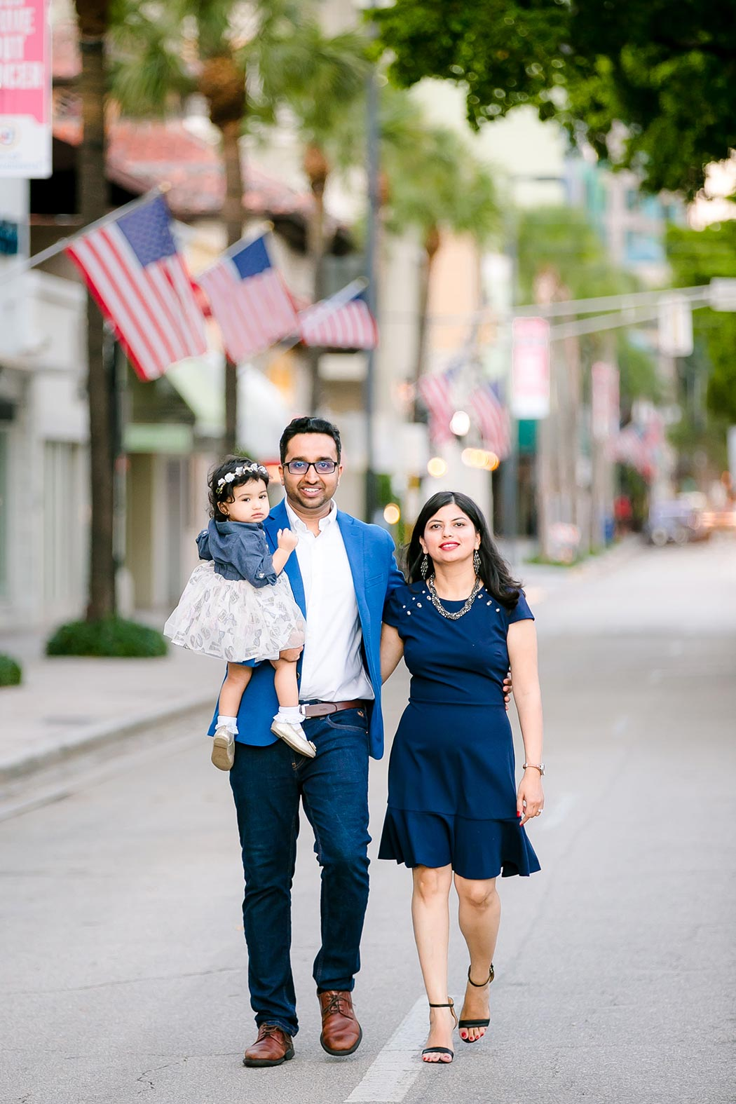 couple walking towards camera for family photography session on las olas boulevard fort lauderdale