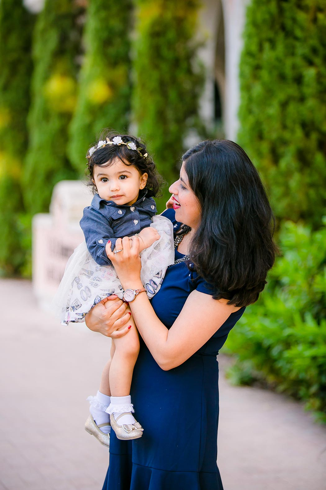 one year old indian girl and her mother posing for family photos in fort lauderdale | las olas boulevard family photography