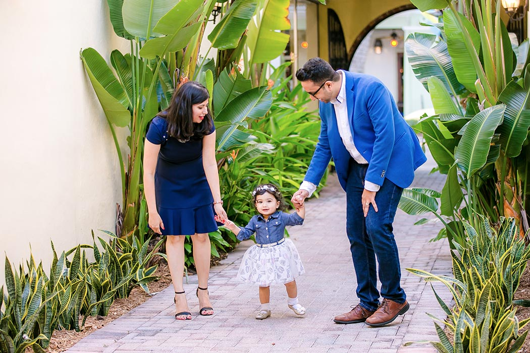 adorable baby walks towards camera during family photography session in south florida